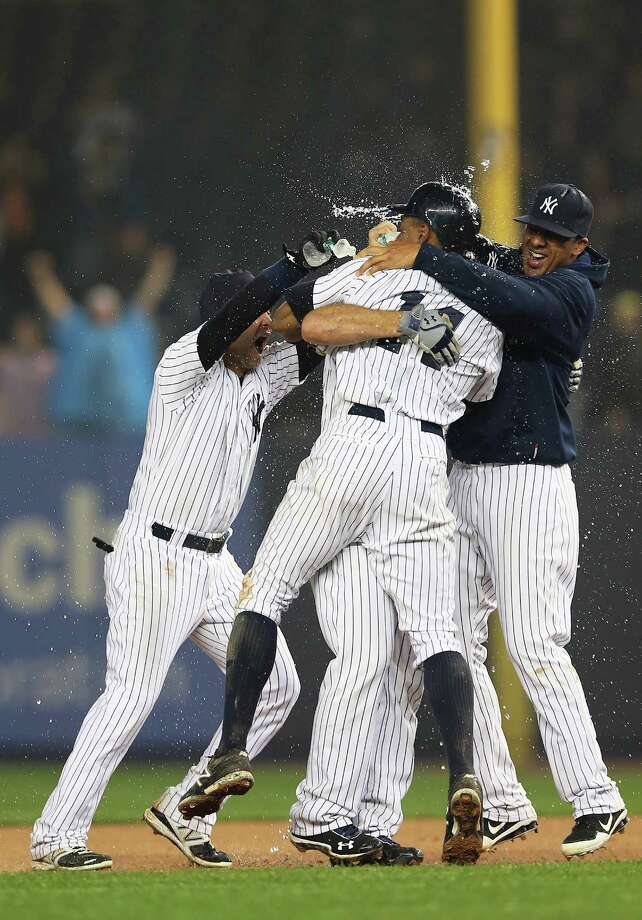 The Yankees used water while mobbing Raul Ibanez on Tuesday but hope to switch to champagne tonight. Photo: Elsa / 2012 Getty Images
