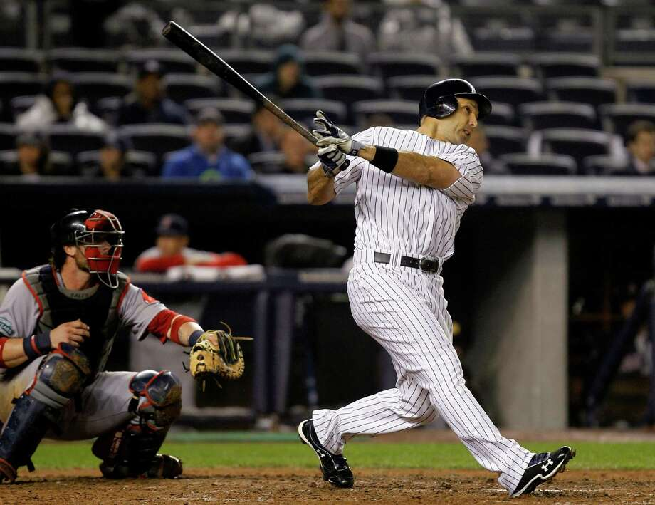 New York Yankees' Raul Ibanez hits a ninth-inning, two-run home run against the Boston Red Sox during their baseball game at Yankee Stadium in New York, Tuesday, Oct. 2, 2012. (AP Photo/Kathy Willens) Photo: Kathy Willens