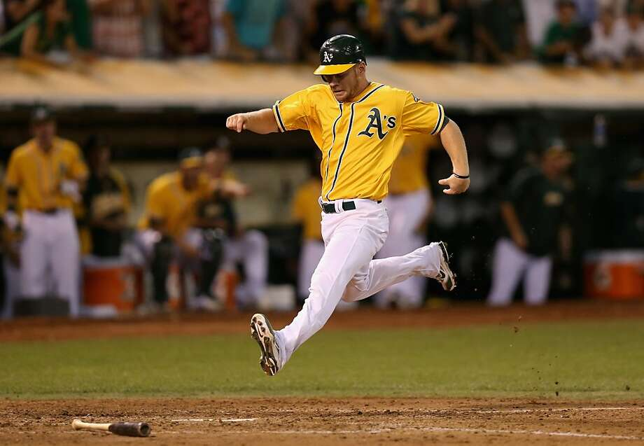 OAKLAND, CA - OCTOBER 02: Brandon Moss #37 of the Oakland Athletics scores on a hit by Derek Norris #36 in the fifth inning of their game against the Texas Rangers at O.co Coliseum on October 2, 2012 in Oakland, California.  (Photo by Ezra Shaw/Getty Images) Photo: Ezra Shaw, Getty Images