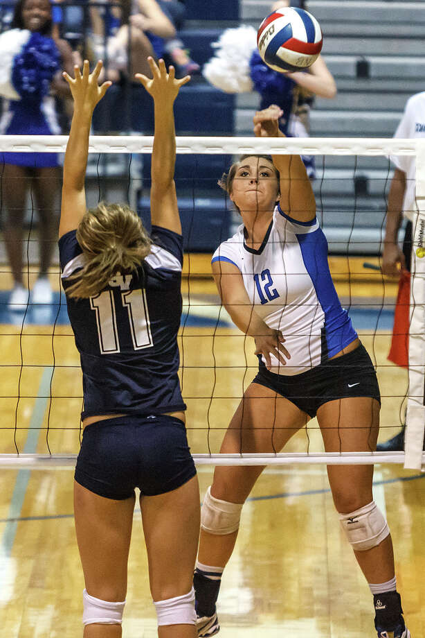 New Branufels' Cassie Reilly (right) gets a shot past Smithson Valley's Emily Medlin during their match at New Braunfels High School on Oct. 2, 2012.  New Braunfels won the match in four sets: 25-19, 25-21, 22-25 and 25-14. Photo: Marvin Pfeiffer, San Antonio Express-News / Express-News 2012