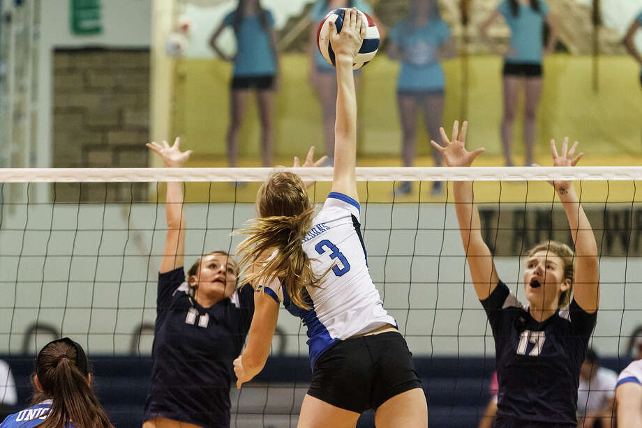 New Braunfels' Katie Steel (3) gets a kill shot between Smithson Valley's Emily Medlin (left) and MccKinlee Boss during their match at New Braunfels High School on Oct. 2, 2012.  New Braunfels won the match in four sets: 25-19, 25-21, 22-25 and 25-14. Photo: Marvin Pfeiffer, San Antonio Express-News / Express-News 2012