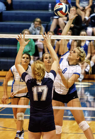 New Braunfels' Morrigan Land (right) goes up for a shot over Smithson Valley's McKinlee Boss during their match at New Braunfels High School on Oct. 2, 2012.  New Braunfels won the match in four sets: 25-19, 25-21, 22-25 and 25-14. Photo: Marvin Pfeiffer, San Antonio Express-News / Express-News 2012