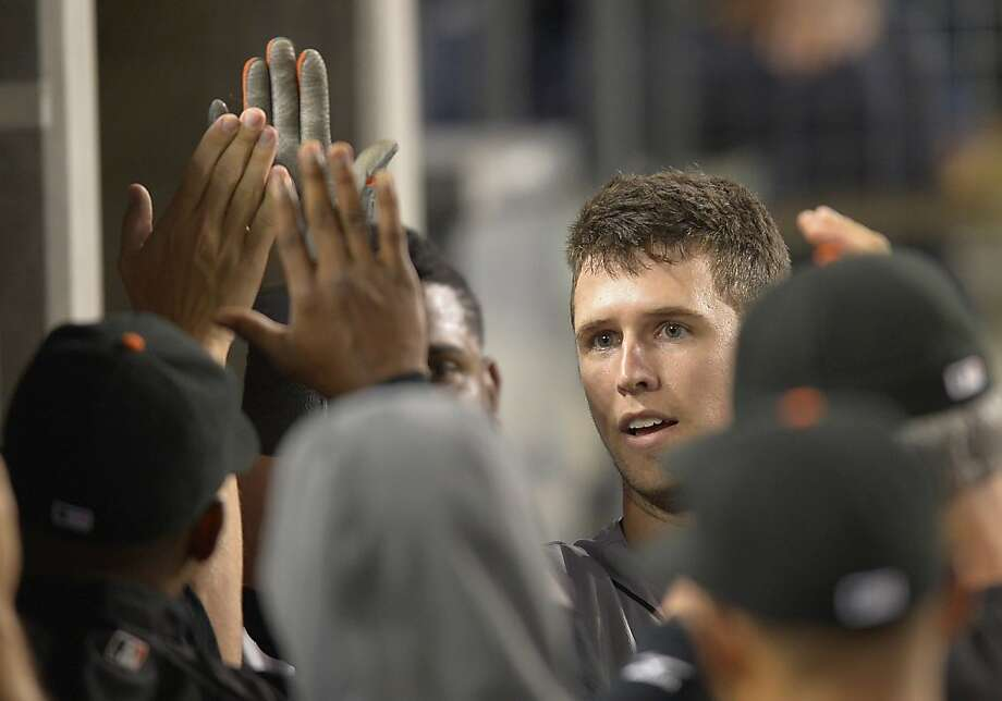 San Francisco Giants' Buster Posey is congratulated by teammates after hitting a solo home run during the second inning of a baseball game against the San Francisco Giants, Tuesday, Oct. 2, 2012, in Los Angeles. Photo: Mark J. Terrill, Associated Press