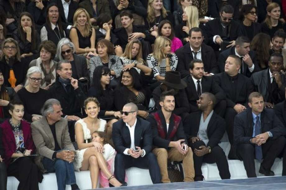 French photographer Patrick Demarchelier (L), US singer Jennifer Lopez (2L), her daughter Emme Maribel Muniz and partner Casper Smart (C), French model Baptiste Giabiconi (3R) and US musician and designer Kanye West (2R) attend the Chanel Spring/Summer 2013 ready-to-wear collection show on October 2, 2012 at the Grand Palais in Paris.  (MARTIN BUREAU/AFP/Getty Images)