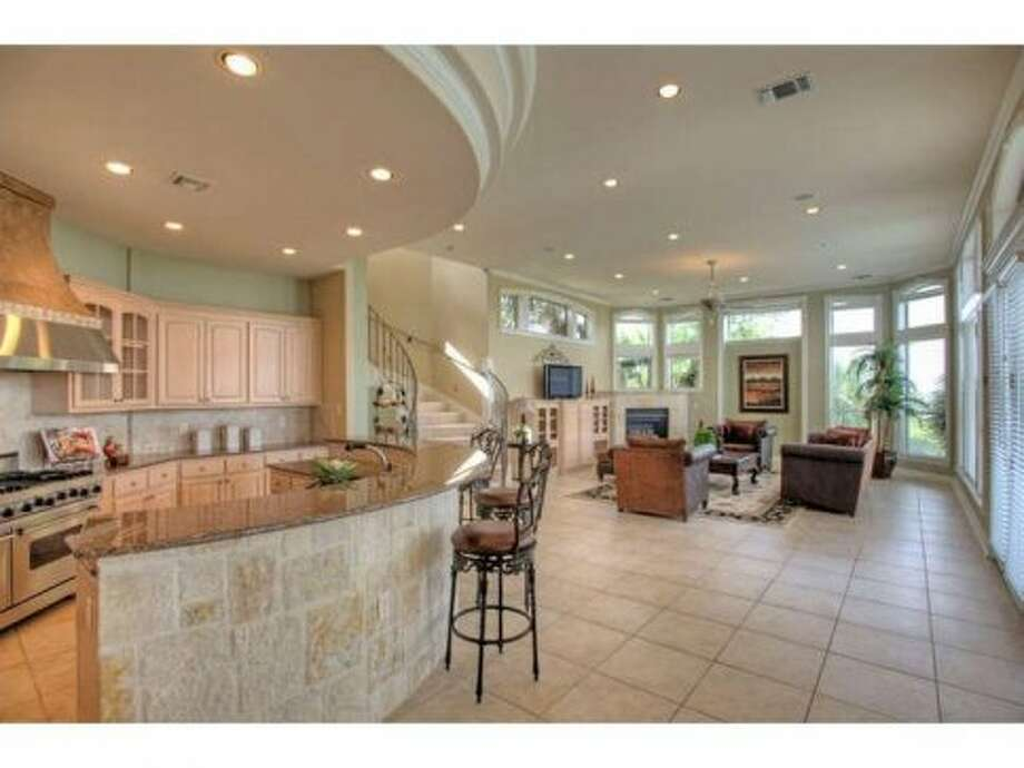 Tile floors cover the kitchen and the entertainment room.
