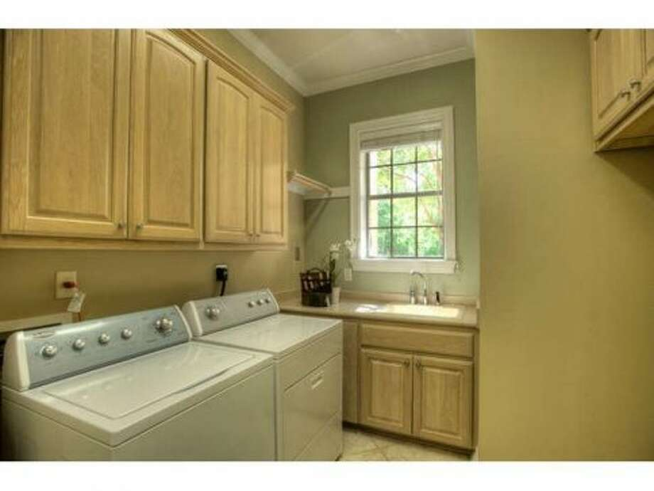 The home comes with a washer and dryer, seen here in the laundry room.