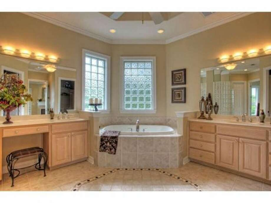 The master bathroom contains a large, relaxing bathtub.