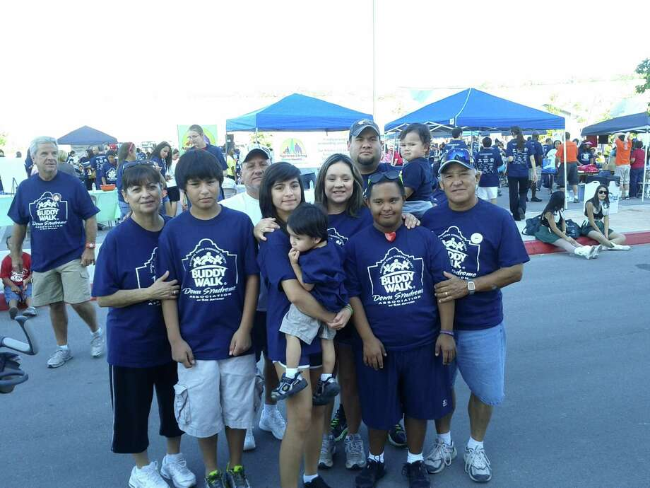 "Members of the Down Syndrome of South Texas take part in the annual ""Buddy Walk,"" an annual fundraiser and Down syndrome awareness event. Photo: Courtesy Photo"