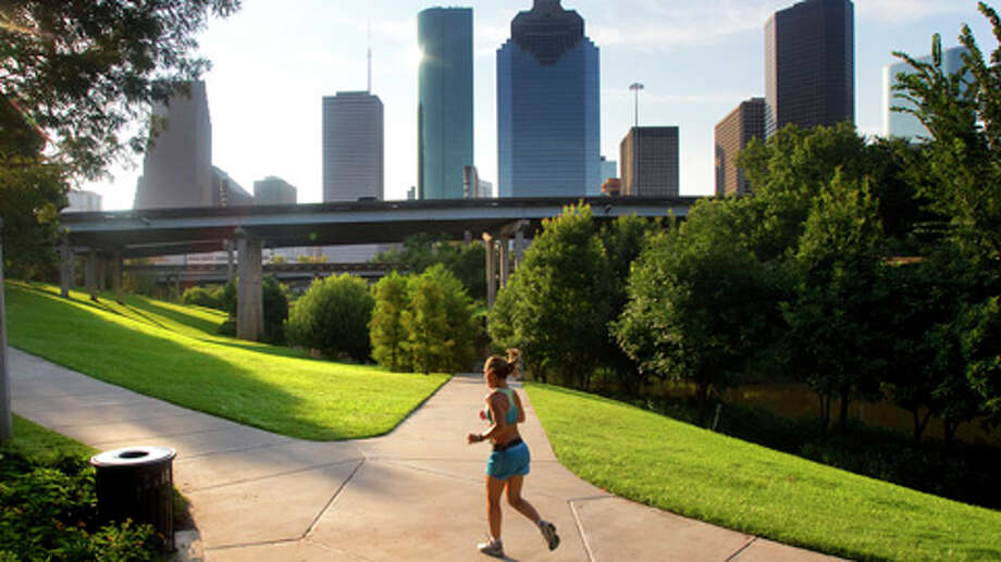 DowntownDirectly west of the central business district is a pretty 5-mile loop — with opportunities for short cuts — that runs along both sides of Buffalo Bayou. A massive project now under construction is transforming the once-neglected green belt into an urban gem. The trail remains navigable, though the south portion is rough in spots. Look for the asphalt path close to the bayou, which is restricted to pedestrian use, unlike the 10-foot-wide concrete trail where bicycles, skateboards and strollers are welcome. It's a little hilly, too. At the farthest point from downtown on the loop is the Shepherd Street bridge. An underpass leads to a sidewalk that will get you to Memorial Park, the heart of Houston's running community, about 1.5 miles west of the bridge.Information current as of January 27, 2015. Photo: Cody Duty, . / © 2011 Houston Chronicle