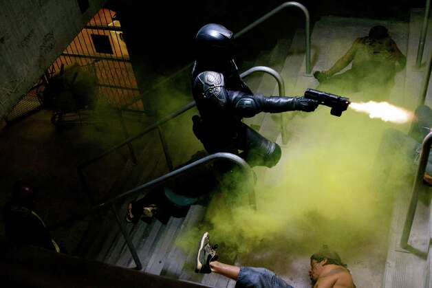"This film image released by Lionsgate shows Karl Urban in a scene from ""Dredd 3D."" (AP Photo/Lionsgate) Photo: AP, HOEP / Lionsgate"