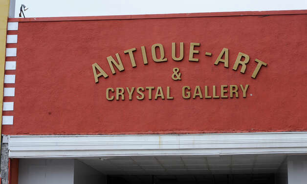"The ""G"" came from this familiar sign outside the entrance of the Antique-Art & Crystal Gallery store located in downtown Beaumont.   Dave Ryan/The Enterprise"