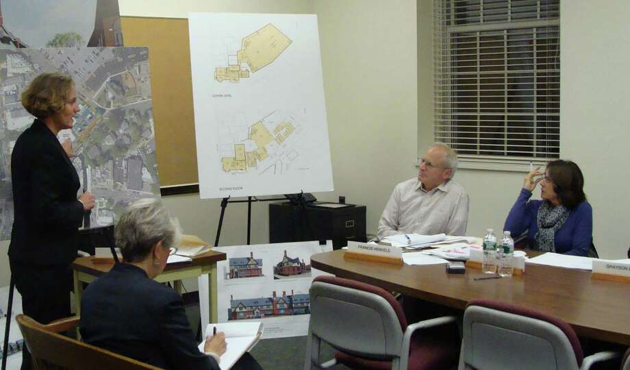Karen Johnson, vice president of development for Charter Realty & Development Corp., goes over some of the details of the Bedford Square project at Tuesday's meeting of the Historic District Commission/Architectural Review Board Joint Committee. Photo: Meg Barone / Westport News freelance