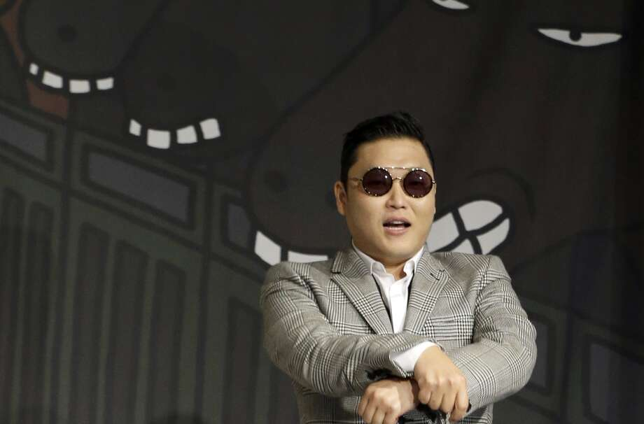 "A local pastor says ""Gangnam Style"" by PSY (left) might help change the way Asian Americans see themselves.  Photo: Lee Jin-man, Associated Press / AP"