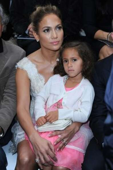Jennifer Lopez and her daughter Emme attend the Chanel Spring / Summer 2013 show as part of Paris Fa