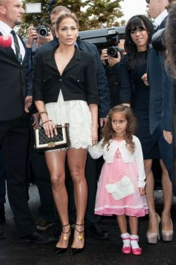 Jennifer Lopez and her daughter Emme arrive at the Chanel Spring / Summer 2013 show as part of Paris Fashion Week at Grand Palais on October 2, 2012 in Paris, France.  (Francois Durand/Getty Images)