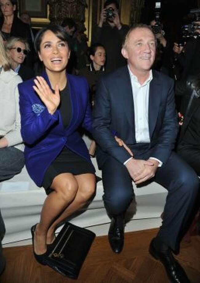 Salma Hayek and her husband Francois Henri Pinault attend the Stella McCartney Spring / Summer 2013 show as part of Paris Fashion Week on October 1, 2012 in Paris, France.  (Pascal Le Segretain/Getty Images)