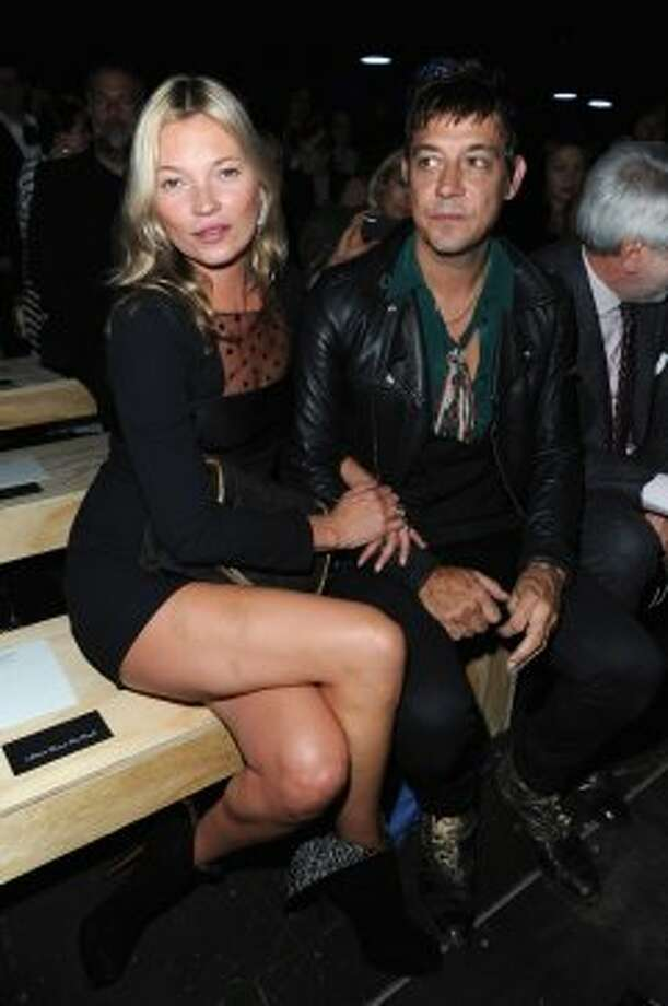 Kate Moss and Kills musician Jamie Hince attend the Saint Laurent Spring / Summer 2013 show as part of Paris Fashion Week on October 1, 2012 in Paris, France.  (Pascal Le Segretain/Getty Images)