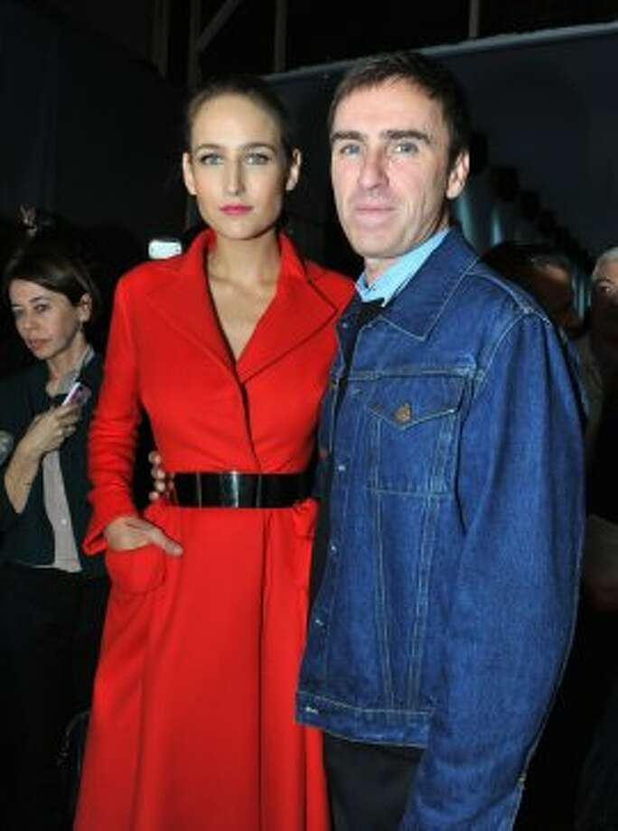 Actress Leelee Sobieski (L) and Head Creative Director at Dior, Raf Simons attend the Christian Dior Spring / Summer 2013 show as part of Paris Fashion Week on September 28, 2012 in Paris, France.  (Pascal Le Segretain/Getty Images)