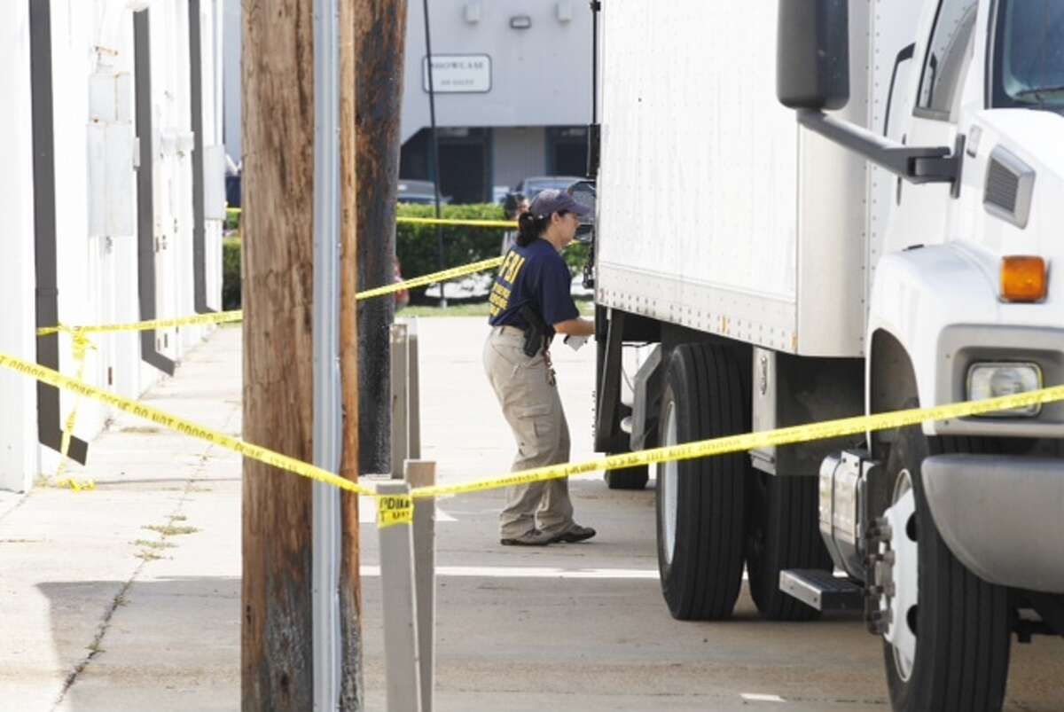 An FBI agent at Arc Electronics Inc. Wednesday, Oct. 3, 2012, during a raid in Houston. (Brett Coomer / Houston Chronicle)