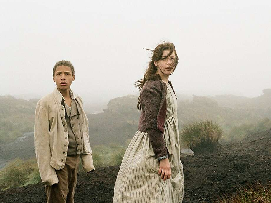 "Young Heathcliff (Solomon Glave) and Catherine (Shannon Beer) on the moors in ""Wuthering Heights."" Photo: Oscilloscope"