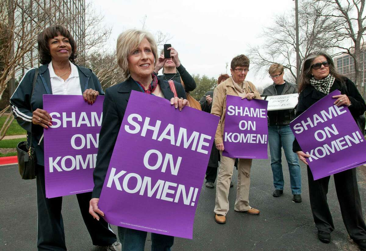 Women protest in February at the Susan G. Komen for the Cure headquarters in Dallas after the decision to eliminate Planned Parenthood grants.
