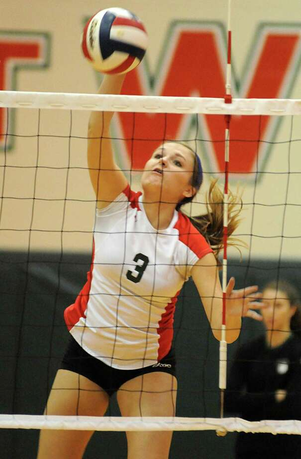 The Woodlands' Madison McDaniel spikes the ball during a recent match against Oak Ridge. Photo: David Hopper / freelance