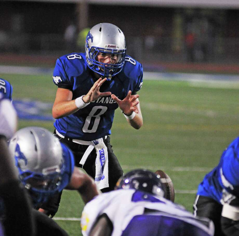 Friendswood quarterback Jordon Wood, No. 8, has led the Mustangs to a 4-0 start to the season. Photo: L. Scott Hainline / For The Chronicle