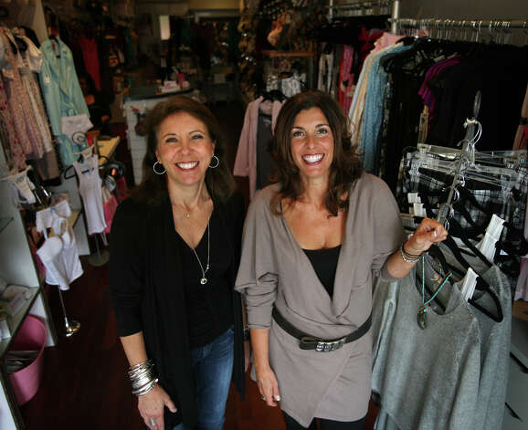 Whispers from Lady Olga lingerie boutique co-owners Jeniene Ferguson, left, and Lori Vazzano at their 21 River Street business in downtown Milford. Photo: Brian A. Pounds / Connecticut Post