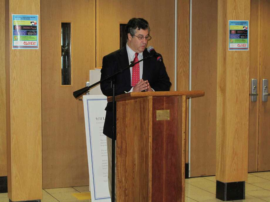 First Selectman Robert Mallozzi reads a proclamation against domestic violence at New Canaan High School. 10/5/12. Photo: Tyler Woods