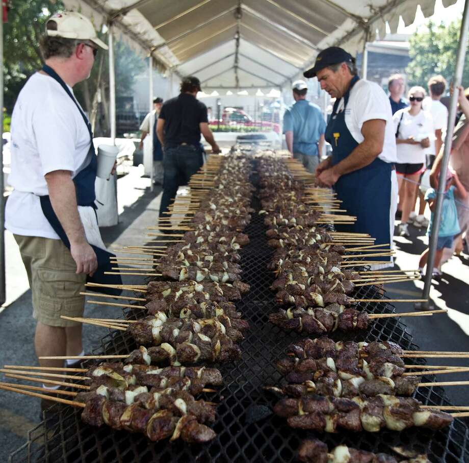 Terry Gazaw (left) and John Krell (right) keep an eye on the grills loaded with the Souvlaki (seasoned and marinated tenderlion cubes with onions) during The Original Greek Festival at Annunciation Greek Orthodox Cathedral complex Sunday, Oct. 10, 2010, in Houston. ( James Nielsen / Houston Chronicle ) Photo: James Nielsen / Houston Chronicle