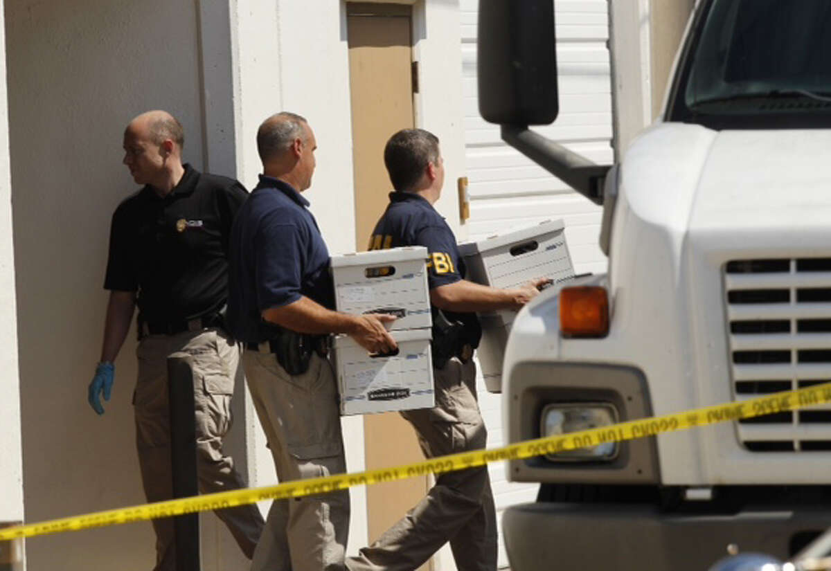 FBI agents at Arc Electronics Inc. Wednesday, Oct. 3, 2012, during a raid in Houston. (Brett Coomer / Houston Chronicle)