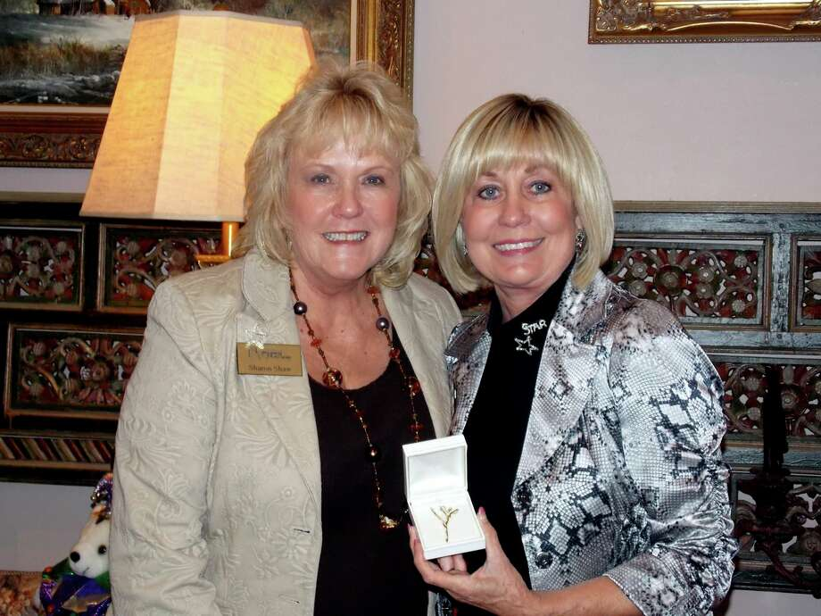 Left, Sharon Shaw, of The Woodlands, receives an award from Montgomery County Performing Arts Society President Mary Wagers-Smith on Sept. 27.
