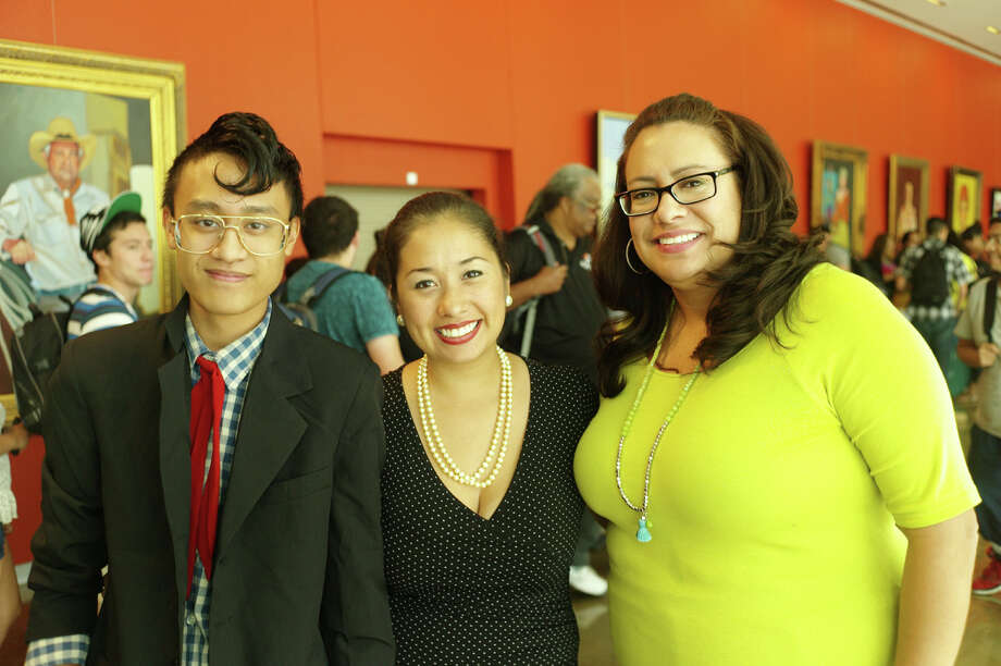 Student Josh Tadeo (from left), speaker  Dulce Matuz and student activities director Carmen Velasquez get  together during the reception for Matuz at Palo Alto College.  Photo: Leland A. Outz, For The Express-News / SAN ANTONIO EXPRESS-NEWS