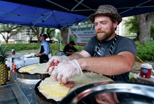 """Buffalo Sean"" from Melange Creperie stays busy at his griddle at the City Hall Farmer's Market. Photo: Andrew Richardson / © 2011 Houston Chronicle"