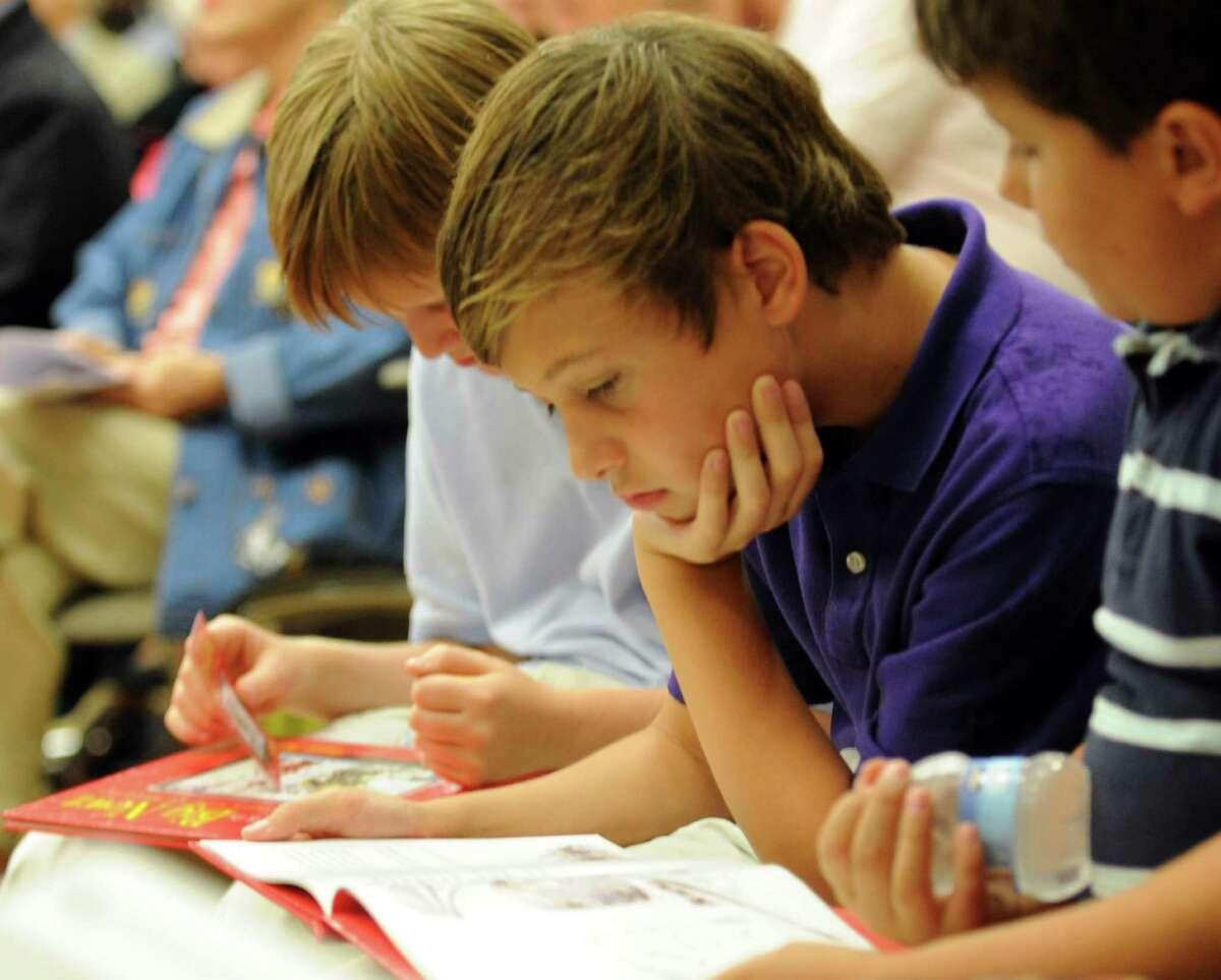 Nicholas Spizzirri, 10, reads news anchor Ernie Anastos' book