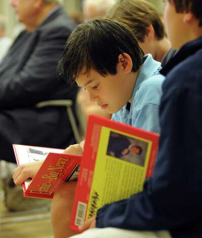 "Andrew Bahl, 10, reads news anchor Ernie Anastos' book ""Ernie and the Big Newz"" during ""Civility in the Media,"" the second installment of the mayor's civility series at the Ferguson Library in Stamford on Wednesday, October 3, 2012. Photo: Lindsay Niegelberg / Stamford Advocate"