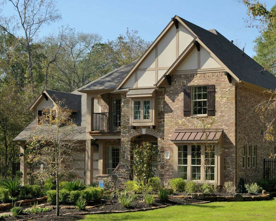 D.R. Horton presents the Thornbury at Golden Orchard in The Woodlands? May Valley. At 3,513 square feet, the two-story home has four bedrooms, dining room, study/optional fifth bedroom, upstairs game room, rear covered patio, 3½ baths and a three-car garage with porte cochere. It is priced from $358,990. / Ted Washington