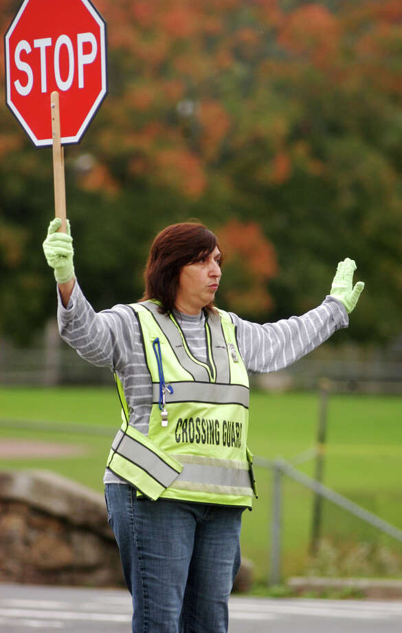 Roseann Bilosi is a crossing guard at Rogers Park Middle School and South Street School in Danbury. Bilosi has been a crossing guard for the past five years. Photographed on Wednesday, Oct. 3, 2012. Photo: John Pirro / The News-Times