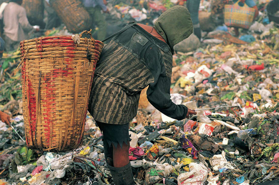 The number of people on the planet has doubled from 3.5 billion to seven billion in just a half century. The most obvious issue with so many of us here is our profligate consumption of dwindling natural resources and the waste and pollution generated in the process. Pictured: A person surviving on waste in the Philippines. Photo courtesy of StockByte/Thinkstock Photo: Contributed Photo