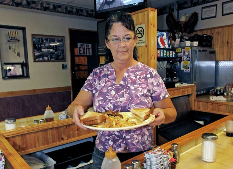 Millie Brown is a cook and waitress at Buch's truck stop, in Steubenville, Ohio. U.S. service companies grew in September at the fastest pace in six months. Photo: Keith Srakocic / AP