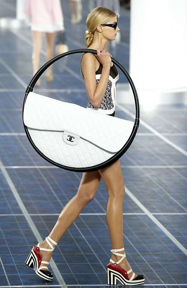 Accessories are so important:A creation by German designer Karl  Lagerfeld for Chanel combines the utility of a large handbag with the  convenience of carrying around a hula hoop. (Paris Fashion Week). Photo: Jacques Brinon, Associated Press