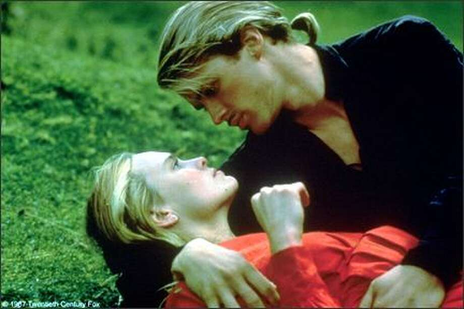 "Kerry Elwes, pictured above cradling Robin Wright as Buttercup, was the swashbuckling lead as Westley. His line to remember – ""Death cannot stop true love. All it can do is delay it for a while."" (Studio photo) Photo: -"