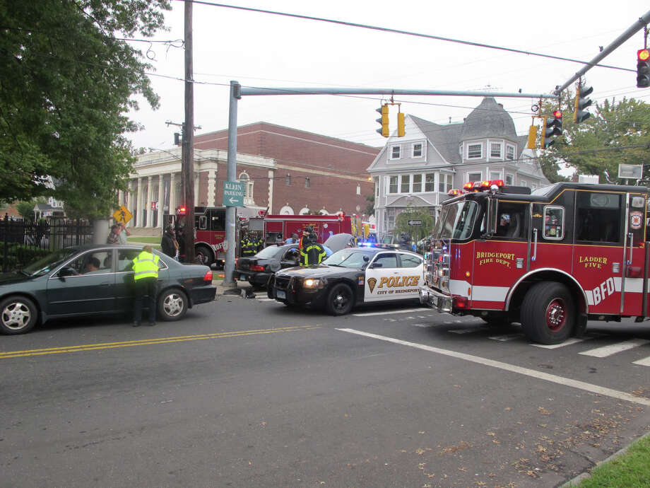 Four people were hospitalized after a three-car crash at the intersection of Fairfield and Iranistan avenues in Bridgeport, Conn. on Wednesday, Oct. 3, 2012. Photo: Tom Cleary