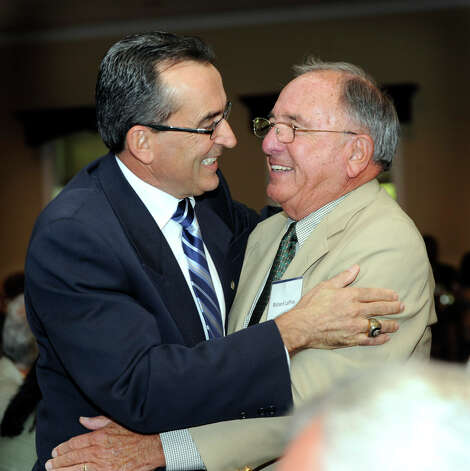 Ray Boa, left, is congratulated by Rich LaPine, who was his teacher at Danbury High School. Boa was named the Constantine S. Macricostas Entrepreneur of the Year at a luncheon held at the Amber Room Colonnade in Danbury Wednesday, Oct. 3, 2012. Photo: Carol Kaliff