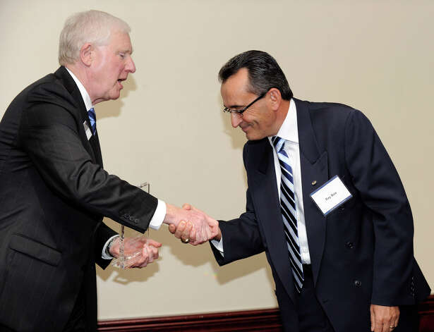 James W. Schmotter, president of Western Connecticut State University, presents Ray Boa, of Brookfield, with the Constantine S. Macricostas Entrepreneur of the Year award, Wednesday, Oct. 3, 2012. Photo: Carol Kaliff