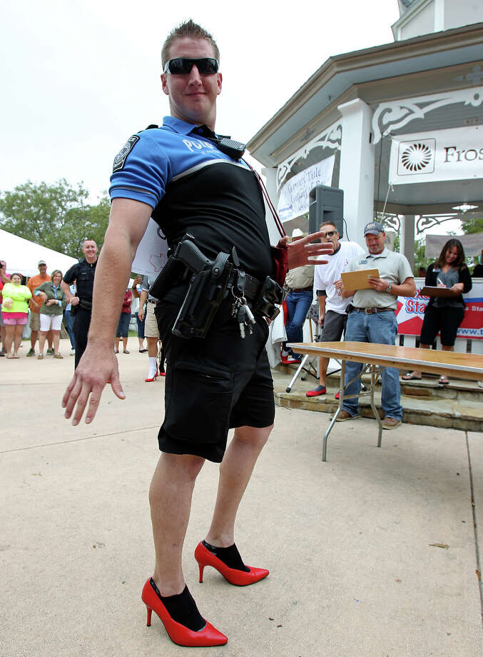 "Oct. 3: Don Pryor, Major U.S. Army (Ret.) listens to proceedings before the Men of Kendall County participate in ""Walk a Mile in Her Shoes"" to benefit the Kendall County Women's Shelter in downtown Boerne. See more: Real Men of Kendall County Walk a Mile in her Shoes Photo: TOM REEL"