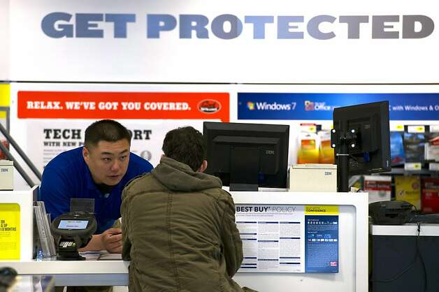 An employee helps a customer at a Best Buy Co. store in Emeryville, California, U.S., on Tuesday, March 27, 2012. Best Buy Co., the electronics, appliance and entertainment retailer, is expected to release quarterly earnings onMarch 29. Photographer: David Paul Morris/Bloomberg Photo: David Paul Morris, Bloomberg