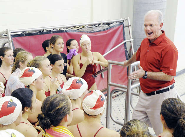 Greenwich High School girls swim coach Dick Hawks, right, speaks with his team at the start of the meet against Darien High School at Greenwich, Wednesday afternoon, Oct. 3, 2012. Photo: Bob Luckey / Greenwich Time