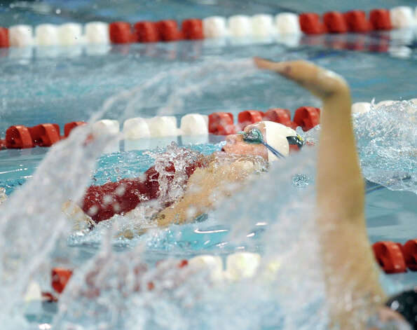 Isobel Walker of Greenwich High School during the backstroke leg of the 200 medley relay event in the girls high school swim meet between Greenwich High School and Darien High School at Greenwich, Wednesday afternoon, Oct. 3, 2012. Photo: Bob Luckey / Greenwich Time