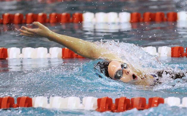 Olivia Leunis of Darien High School swims the backstroke leg during the 200 IM event in the girls high school swim meet between Greenwich High School and Darien High School at Greenwich, Wednesday afternoon, Oct. 3, 2012. Photo: Bob Luckey / Greenwich Time